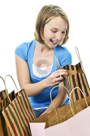Teenage girl with shopping bags stock photo, Happy teenage girl with lots of shopping bags by Elena Elisseeva