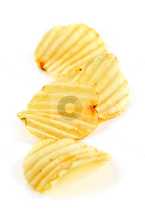 Potato chips stock photo, Several potato chips isolated on white background by Elena Elisseeva