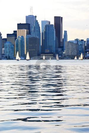 Toronto skyline stock photo, Toronto harbor skyline with skyscrapers and sailboat by Elena Elisseeva