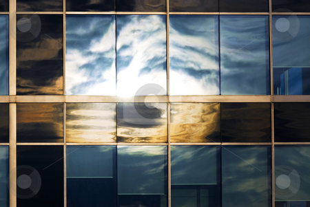 Sky reflecting in office windows stock photo, Reflection of a cloudy sky in glass wall of an office building by Elena Elisseeva