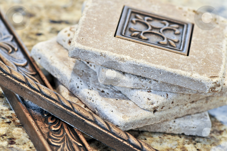 Ceramic tiles and borders stock photo, Ceramic tiles and borders for backsplash close up on a granite surface by Elena Elisseeva