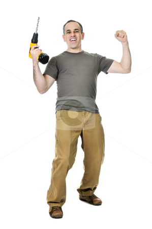 Handyman with a drill stock photo, Happy handyman raising his drill in victory by Elena Elisseeva