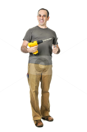 Handyman with a drill and screwdriver stock photo, Happy handyman holding a drill and screwdriver by Elena Elisseeva