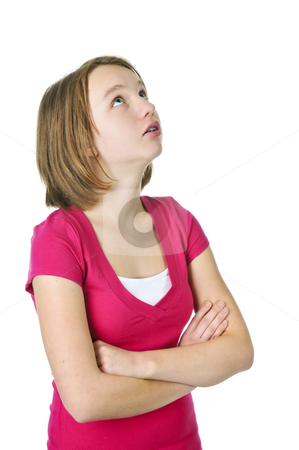 Teenage girl looking up stock photo, Teenage girl rolling her eyes in frustration by Elena Elisseeva