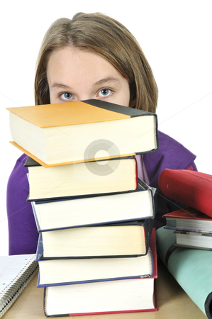 Teenage girl studying stock photo, Frustrated teenage girl studying at the desk with big stack of books by Elena Elisseeva