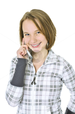 Teenage girl talking on phone stock photo, Teenage girl talking on a cell phone isolated on white background by Elena Elisseeva