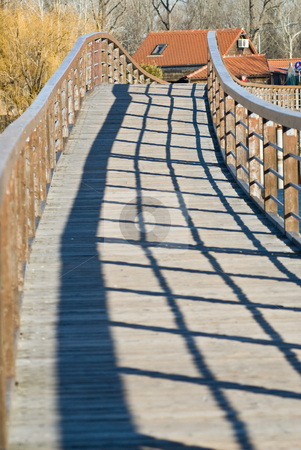 Bridge with shadow stock photo, A bridge in bright sunlight with the balustrade throwing a shadow by Alexander L?