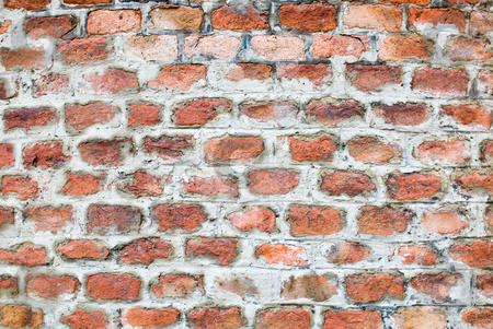 Old brickwall stock photo, A old aged wall built with red bricks by Alexander L?