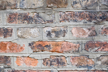 Old brickwall stock photo, A old aged and dirty wall built with red bricks by Alexander L?