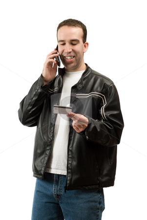 Credit Card Payment stock photo, A man giving his credit card over the phone to pay for something, isolated against a white background by Richard Nelson