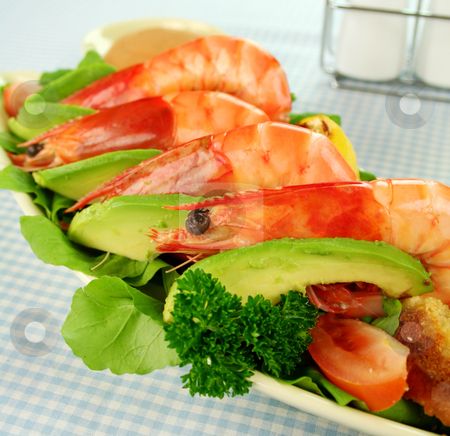 Shrimp And Avocado Salad stock photo, Freshly prepared shrimps with rocket salad with avocado and dressing. by Brett Mulcahy