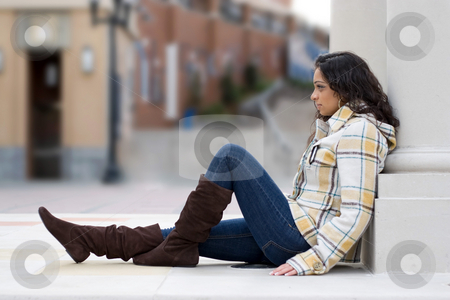 Young Indian Woman stock photo, A young Indian woman posing outdoors in an urban setting. Shallow depth of field. by Todd Arena