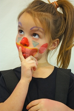 Girl with painted face stock photo, Little girl with painted face by Gregory Dean