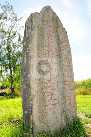 Rune stone stock photo, Ancient rune stone in Sweden by Magnus Johansson