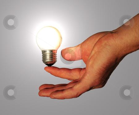 Manpower stock photo, Lightbulb powered by human by Magnus Johansson