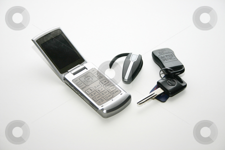 Cell phone with accesories stock photo,  by Ralph Muzio