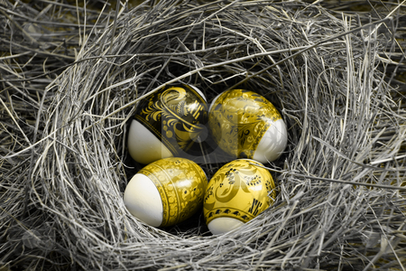 Peaster egg stock photo, Four Easter eggs lie in a nest by Aleksandr GAvrilov