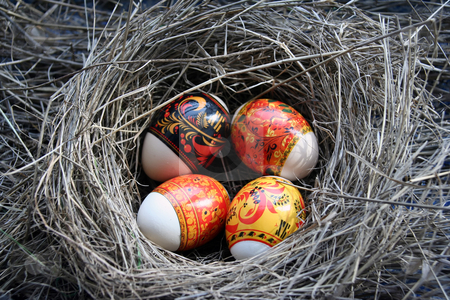 Peaster egg stock photo, Four Easter eggs lie in a nest by Aleksandr GAvrilov