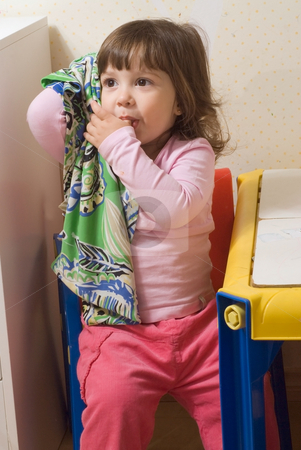 Cute Little Girl stock photo, Cute little girl sucking her thumb and holding onto her blankie. by Orange Line Media