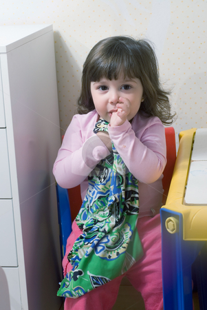 Girl with Blankie stock photo, Adorable little girl clutching her blankie and sucking her thumb by Orange Line Media