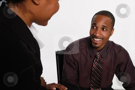Surprised Businessman - Horizontal stock photo, Isolated businessman looking surprised at a female coworker. by Orange Line Media