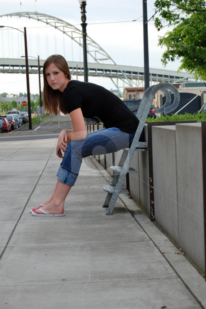 Teen Sitting on Stairs - Vertical stock photo, Vertically framed outdoor shot of a teenage girl sitting on stairs. by Orange Line Media