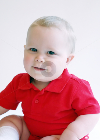Toddler Boy - Smiling stock photo, Portrait of a smiling toddler boy wearing a red polo-shirt. by Orange Line Media