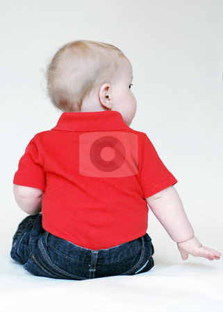 Toddler Looking Away stock photo, Portrait of a toddler with his back to the camera wearing red shit and blue jeans. by Orange Line Media
