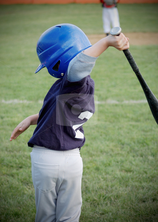 Boy Swinging Baseball Bat stock photo, Young boy taking some practice swings as he prepares to go to the plate to hit by Orange Line Media