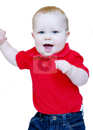 Standing Toddler stock photo, Portrait of a toddler boy standing, wear a red shirt and blue jeans, holding his parents hand while smiling. by Orange Line Media