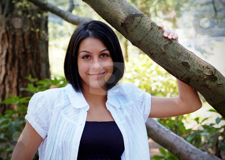 Cute Brunette stock photo, Attractive young woman smiling at the camera. Horizontally framed shot. by Orange Line Media