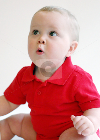 Baby Looking Up stock photo, Portrait of a surprised baby boy looking up wearing a red polo-shirt. by Orange Line Media