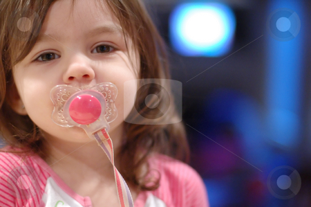 cute young girl with pacifier horizontal stock photo