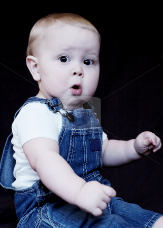 Surprised Toddler stock photo, Portrait of a suprised toddler boy wearing overals. by Orange Line Media
