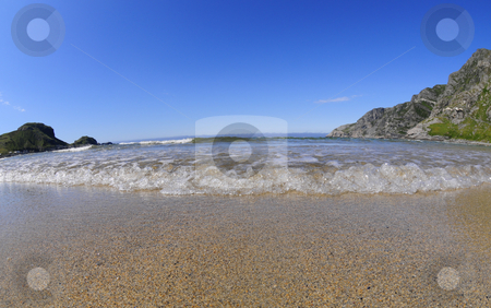 Beach stock photo, Empty beach with clear water and blue sky by Magnus Johansson