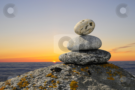Soft stones in sunset stock photo, Nice smooth stones on a cliff with beautiful sunset background by Magnus Johansson