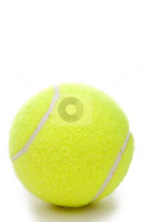 A vertical closeup of a yellow tennis ball on a white background stock photo, A vertical closeup of a yellow tennis ball on a white background by Vince Clements