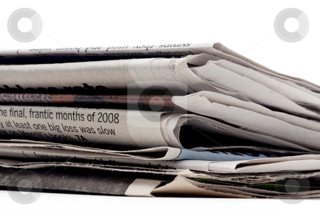 Horizontal view of a stack of newpapers on a white background stock photo, Horizontal view of a stack of newpapers on a white background by Vince Clements