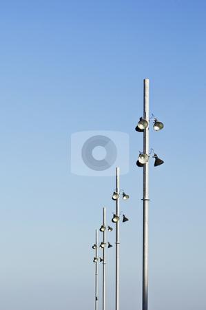 Streetlight stock photo, Modern streetlights against a clear blue sky by Manuel Ribeiro