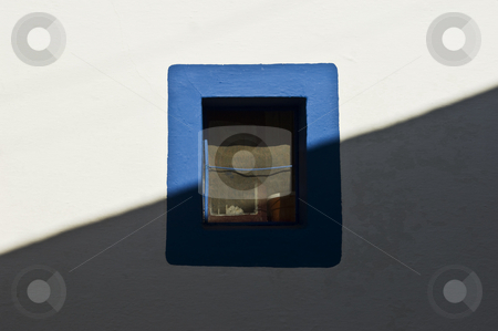 Small window stock photo, Small window painted with a blue border by Manuel Ribeiro