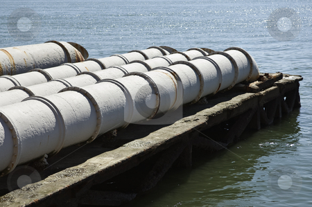 Sewage into the river stock photo, Sewage pipes leading to the river water by Manuel Ribeiro