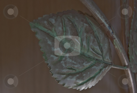 Close up Photo of a Metal Leaf stock photo, This photo is a closeup of a silver colored metal leaf with green highlights and patterns.  A unique spin from regular foliage. by Valerie Garner