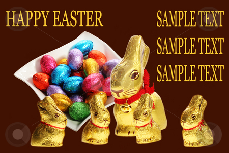 Golden chocolate Easter bunnies stock photo, Golden chocolate Easter bunnies isolated with area for text by Christopher Meder