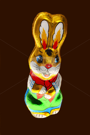chocolate Easter bunn stock photo, A golden chocolate Easter bunny isolated with area for text by Christopher Meder