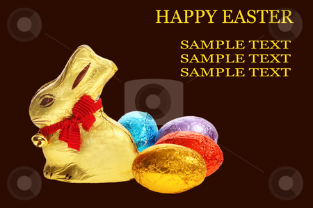 Golden chocolate Easter bunny with eggs stock photo, A golden chocolate Easter bunny with eggs isolated with area for text by Christopher Meder