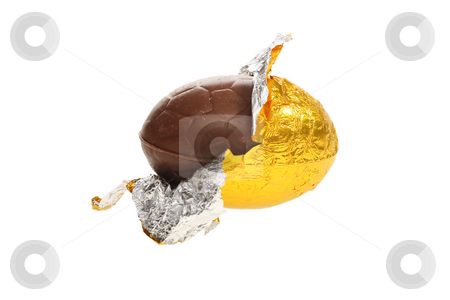 Easter chocolate egg stock photo, Easter chocolate egg, opened in gold foil by Christopher Meder