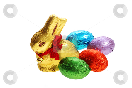 Golden chocolate Easter bunny with egg stock photo, A golden chocolate Easter bunny with eggs isolated with area for text by Christopher Meder