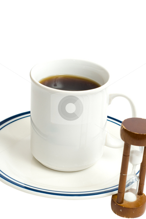 Coffee Time stock photo, Conceptual image of coffee time with a full cup and an hourglass by Richard Nelson