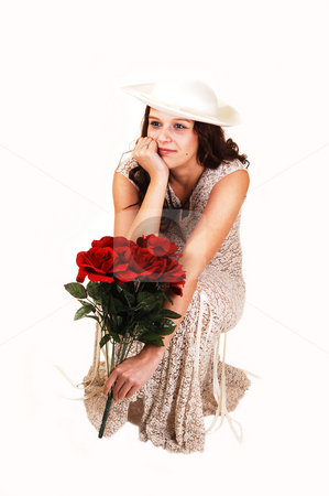 Woman with hat and roses. stock photo, A young girl standing with the back to the camera in white thongs holding her nice bottom with both of her hands. by Horst Petzold