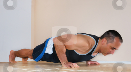 Man Doing Push Ups stock photo, Strong man in tank top doing push ups on the floor. by Denis Radovanovic